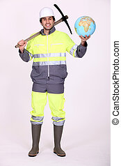 Labourer holding a globe and a pickaxe
