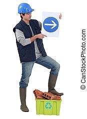 Labourer holding a traffic sign