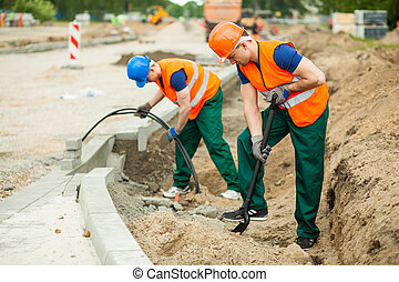 Labourers on a road construction