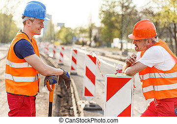 Labourers talking during break