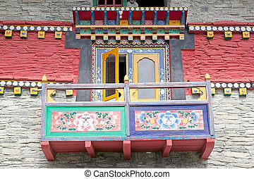 Decorated balcony at the Labrang Gompa, Sikkim, India. It is a octagonal shape gompa along the road to Gagtok. The gompa is a Buddhist ecclesiastical fortification.