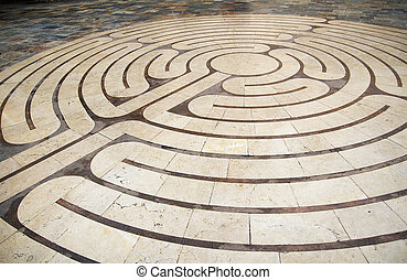 """Concentric circles engraved in the ground, shaping a labyrinth. This representation was shot on the """"place de la poisonnerie"""" square at Grasses city, close to Cannes, on the french riviera."""