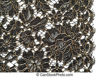 Lace. - Black and gold lace on a white background.