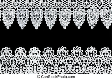 Lace Borders - White lace forms a delicate border against...