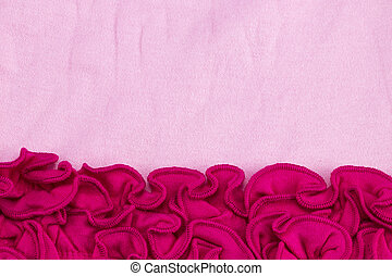 Lace flowers frame close up on Pink Fabric texture