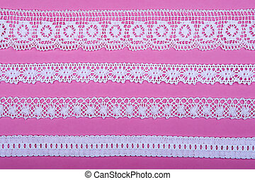 Lace set - 4 different lace borders against pink background.