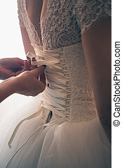 lace wedding dress back of a young bride