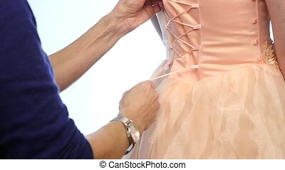 lacing pink wedding dress on a white background. slow motion...