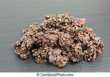 lactose-free and glutenfree snack of puffed quinoa crispies with chocolate and cornflakes