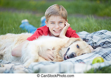 Lad and his pet - Portrait of cute lad and his fluffy pet...