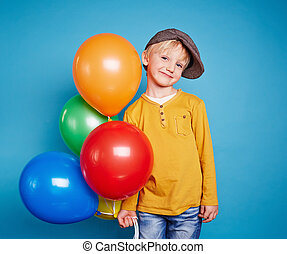 Lad with balloons