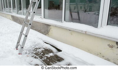 ladder greenhouse snow - ladder stand near conservatory...