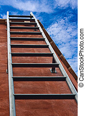 Ladder leading up to the blue sky