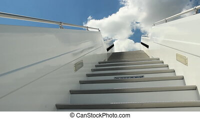 Ladder of the plane - White ladder of the plane against the...