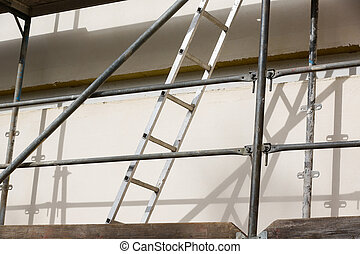 Ladder on a metal scaffold