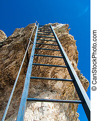 Ladder to the sky with rocks and blue sky on the background
