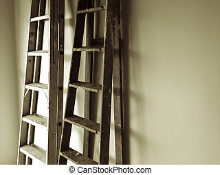 Ladders leaning up against wall