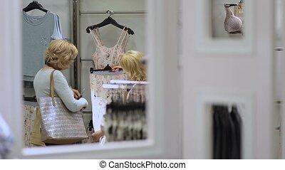 Ladies choosing pajamas and sleepwear in shop