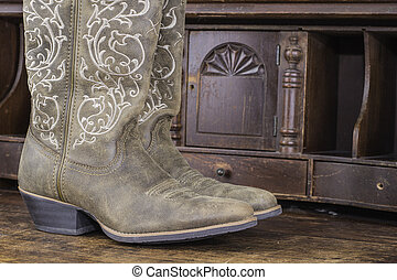 Ladies Cowboy Boots - A pair of cowboy boots sitting on a...