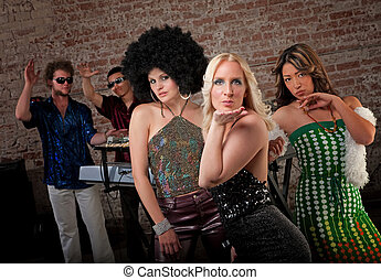1970s Disco Music Party - Ladies in Retro clothing at a...
