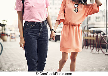 Ladies walking together on street