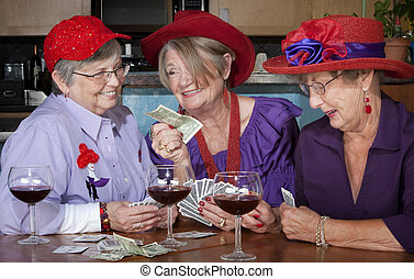 Ladies wearing red hats playing cards - Ladies wearing red ...