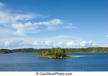Ladoga lake with small island under sunlight