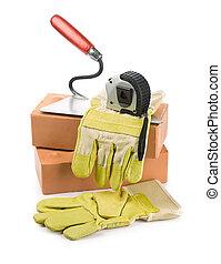 Ladrillos, herramientas, trabajando