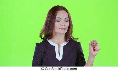 Lady advertises bitcoin and shows a thumbs up. Green screen...