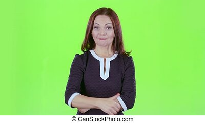 Lady advertises the products and shows a thumbs up. Green screen