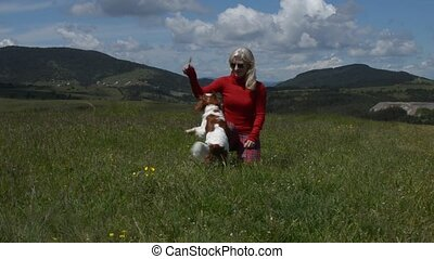 Lady and Doggy - Lady playing with her dog (Cavalier King...