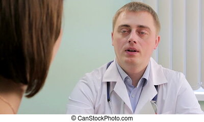 Lady at the doctor - Doctor consults the patient