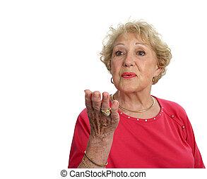 Lady Blows Kiss - A beautiful senior lady blowing a kiss....