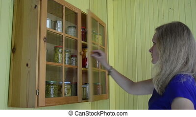 lady cabinet canned food