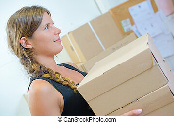 Lady carrying stack of boxes
