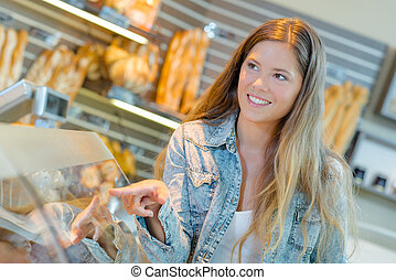 Lady choosing  in a bakery