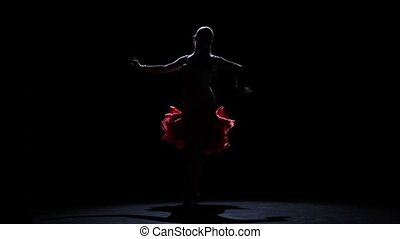 Lady dancing passionate rumba, silhouette. Slow motion
