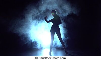 Lady dancing samba in the studio, silhouette. Slow motion
