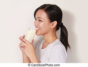lady drinking a glass of milk