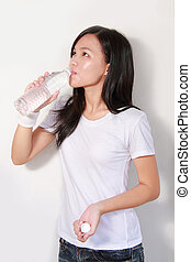 Lady drinking bottle of water