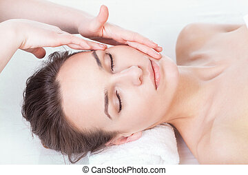 Lady during face massage