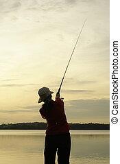 Lady fishing at dawn