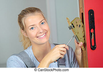 Lady fitting lock system to door