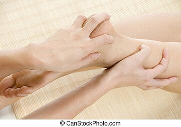 lady getting feet massage