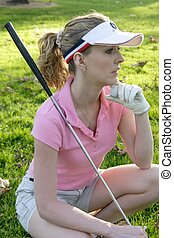 Lady golfer waiting to tee off