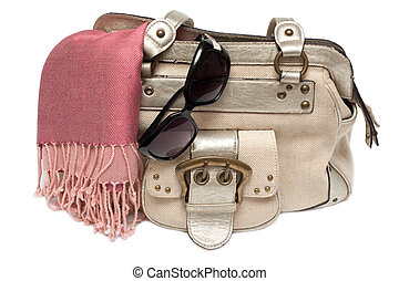Lady hand-bag in rose charge and sun-protective spectacles