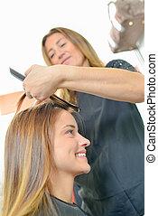 Lady having hair done