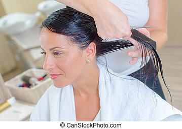 Lady having haircut