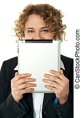 Lady hiding her face with ipad