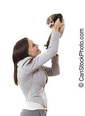 Lady holding a ferret